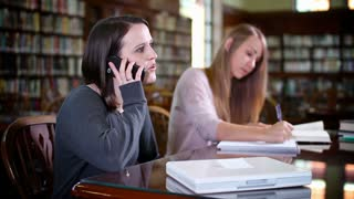 Distracting Student in Library on Cell Phone
