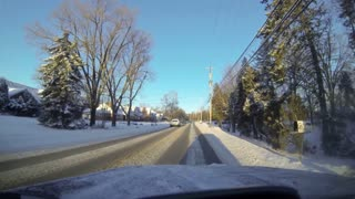 Driving in a neighborhood in the winter.
