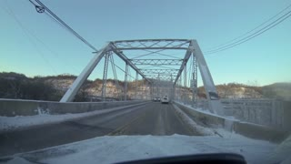 Driving over the Ambridge bridge in the winter.