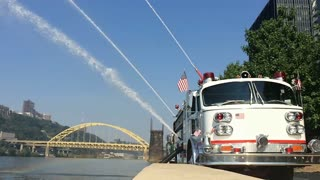 Firetrucks display the power of their water jets at the Mon Wharf in Pittsburgh. Shot at 120fps slow motion.