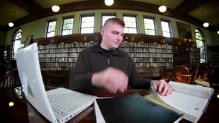 Frustrated Student in College Library Studying