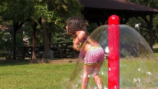 Little Girl Plays in Water