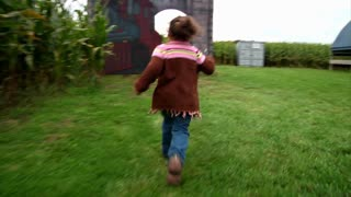 Girl Runs into Corn Maze 982