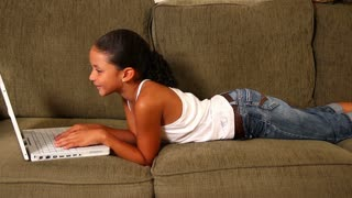 Girl Uses Laptop on Sofa 1819