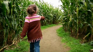 Girl Walks Thru Corn Maze 983