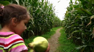 Girl Walks Thru Corn Maze 986
