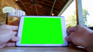 Green Screen Tablet PC on a Restaurant Table 3606