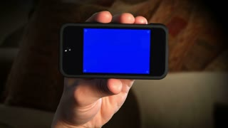 Holding Smartphone Blue Screen