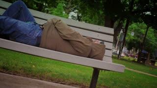 Homeless Man on Park Bench