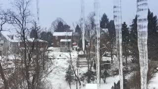 Icicles and falling snow.  Shot at 120fps for true in-camera slow motion.