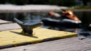 Jet Ski Docked on Lake Background