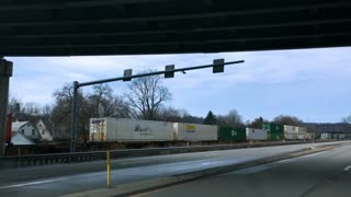 LEETSDALE, PA - Circa February, 2017 - Driving along side a cargo train on Route 65 just north of Pittsburgh on an overcast winter day.