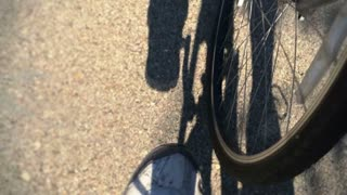 Low perspective of a biker pedaling.