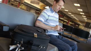 Man at Airport with Smartphone