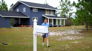 Man Checks Mail Outside of Home