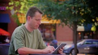 Man Reads eBook Outside 3621