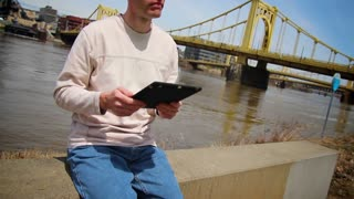 Man Using an iPad Outside