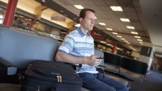 Man with Smartphone in Airport