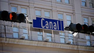 Mardi Gras Beads Hang from Canal Street Sign 4069