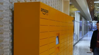 Circa December, 2016 - A man picks up his order from an Amazon Locker station located in a mall.
