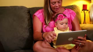 Mother with Baby and Tablet PC Videochat Facetime