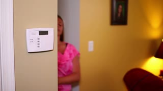Mother with Baby Arms a Home Security System 2204