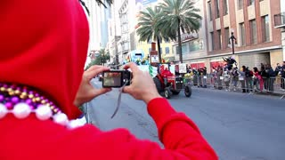 NEW ORLEANS, LA - Circa, February, 2012 - People watch and take pictures of passing floats during a Mardi Gras parade on Canal Street. Editorial use only.