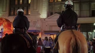 New Orleans Police Officers Watch a Mardi Gras Parade from Horseback