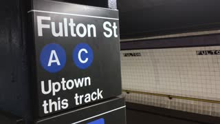 NEW YORK - Circa August, 2016 - An uptown subway train approaches the Fulton Street A-C platform. With audio.