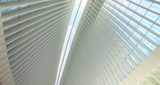NEW YORK - Circa August, 2016 - Looking up at the ceiling of the new Oculus transportation and shopping hub at the base of the World Trade Center. The new Freedom Tower can be seen through the center of the glass ceiling.