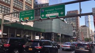 NEW YORK - Circa August, 2016 - Manhattan rush hour traffic heads to the Holland Tunnel.