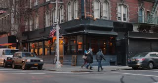 NEW YORK - Circa December, 2016 - A daytime winter establishing shot of a typical Manhattan corner bar and restaurant. Greenwich Village area