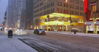 NEW YORK - Circa December, 2016 - A morning wintry establishing shot of traffic and upscale businesses on 5th Avenue in Manhattan. DX.
