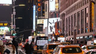 NEW YORK - Circa December, 2016 - A nighttime establishing shot of busy activity in Times Square in New York City.