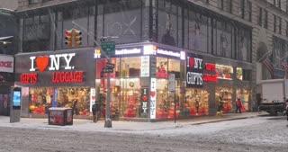 NEW YORK - Circa December, 2016 - A snowy establishing shot of a New York City gift shop in Manhattan.