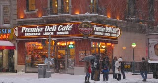 NEW YORK - Circa December, 2016 - A winter establishing shot of a typical Manhattan corner deli or restaurant.