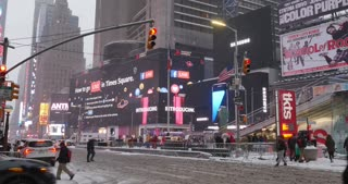 NEW YORK - Circa December, 2016 - A wintry establishing shot of activity at Times Square in Midtown Manhattan.