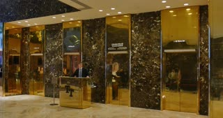 NEW YORK - Circa December, 2016 - An establishing shot of the elevator banks inside the lobby of Trump Tower.