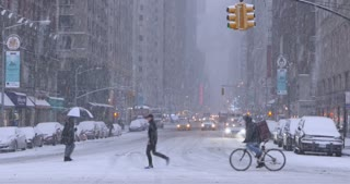NEW YORK - Circa December, 2016 - Traffic and pedestrians on 6th Avenue in Manhattan during a snowstorm. DX.