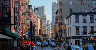 NEW YORK - Circa July, 2016 - A day time lapse view of a busy street in the Little Italy neighborhood in Manhattan.