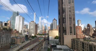 NEW YORK - Circa July, 2016 - A passenger's forward perspective riding the Roosevelt Tramway to Manhattan.