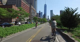 NEW YORK - Circa July, 2016 - Following a bicyclist riding on the Hudson River Greenway bike trail in Manhattan.