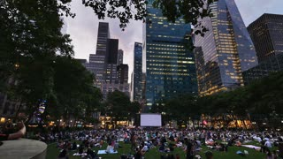 NEW YORK - Circa July, 2016 - People in Bryant Park wait for a movie to play on the big screen on a warm summer's evening.