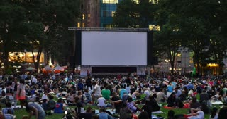 NEW YORK - Circa July, 2016 - People wait in Bryant Park for a movie to play on the big screen.