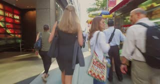 NEW YORK - Circa July, 2016 - People walk on the busy sidewalks of Manhattan on a weekday morning.
