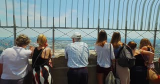 NEW YORK - Circa July, 2016 - Tourists atop the Empire State Building enjoy the view of Manhattan on a summer's day.	 Editorial use only.