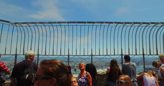 NEW YORK - Circa July, 2016 - Tourists atop the Empire State Building enjoy the view of Manhattan on a summer's day.	 For editorial use only.