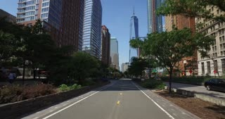 NEW YORK - Circa July, 2016 - View of lower Manhattan and the Freedom Tower as seen from the Hudson River Greenway bike path.