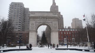 NEW YORK CITY - Circa December, 2013 - Visitors walk in near the Washington Square Arch on the grounds of Washington Square Park in Manhattan in the winter.
