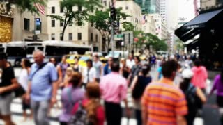NEW YORK CITY - Circa, July, 2014 - An defocused extreme slow motion 120fps shot of pedestrians crossing the streets of Manhattan.